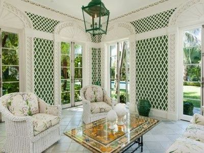 This is a cheery conservatory.  love the walls!