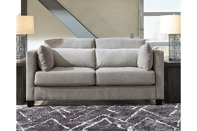 Down with uptown style The Chimone loveseat goes to town with a