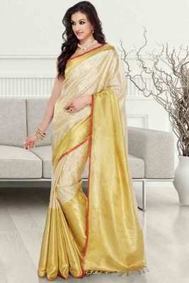5cf78df846 Pale gold & cream tissue brocade zari weaved saree in rust border ...