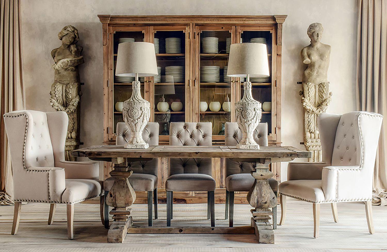Ambiente elegante formado por una mesa de madera con patas for Patas para sillones
