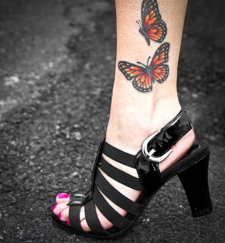 schmetterling tattoo motiv bein monarchfalter orange. Black Bedroom Furniture Sets. Home Design Ideas