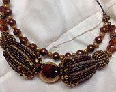 Glitz. Statement necklace. Two large cluster beads double strung on leather and wire.