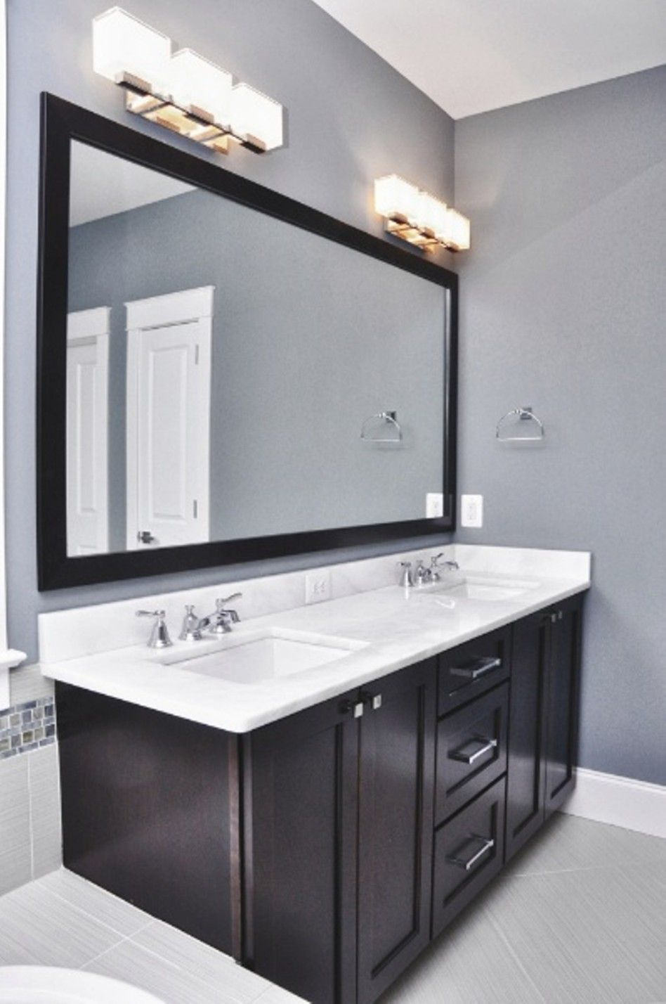 Bathroom Charming Lighting Fixtures Over Mirror Elagant Grey Wall And Dark Wood Cabinet With Light White