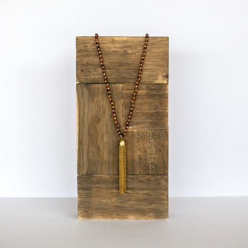 Cedar Sashi Tassel Necklace. At BeRobinHood.com every purchase benefits those in need, twice. Delicate, dainty, and darling. The Sashi Tassel is sure to give your outfit that extra dose of fancy!
