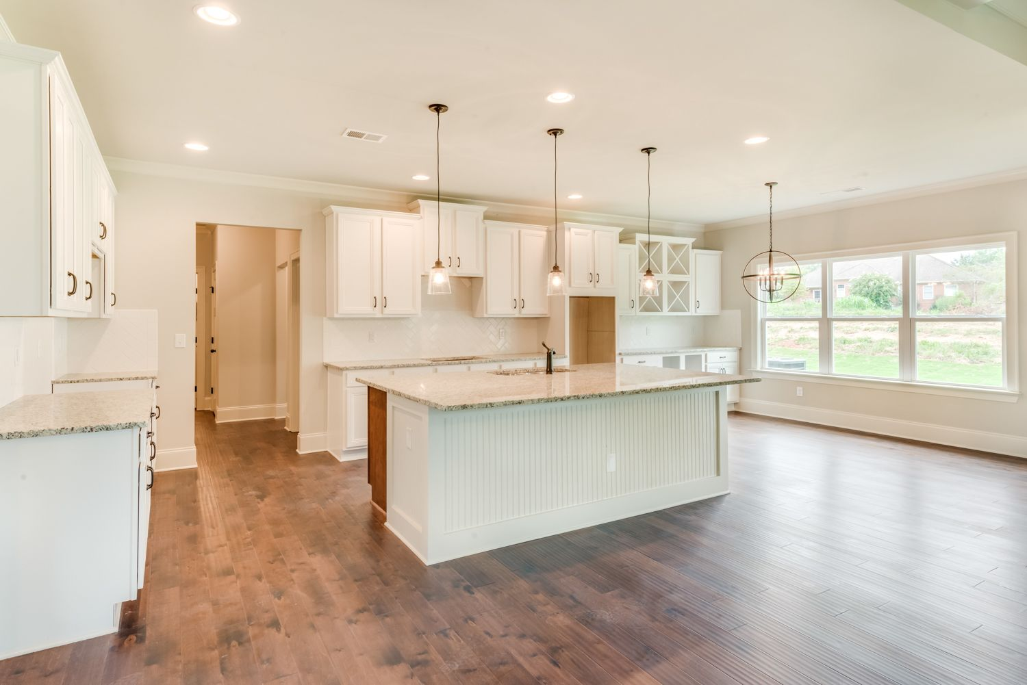 This kitchen is huge!! The white cabinets and white subway ...