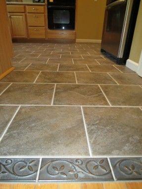 carpet transition ideas | pretty floral borders of kitchen tile