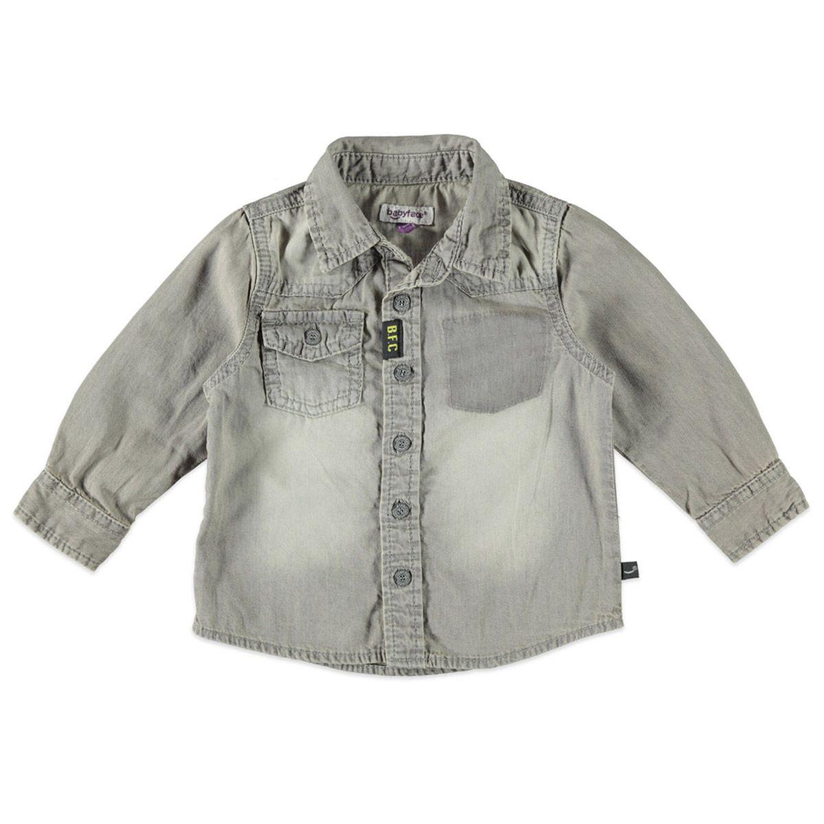Babyface overhemd met knoopsluiting voor jongens in de kleur grijs. Dit Babyface overhemd uit de winter collectie, is gemaakt van 100% katoen en een echte musthave! Draag hem op een Babyface broek of een jeans! Verkrijgbaar in de maten 68 t/m 104. Op de rechter voorkant een pocketzak met afsluitbare klep.
