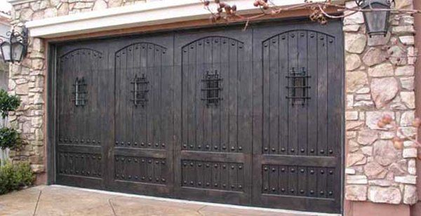 Custom Wood Doors With Clavos Speak Easy S Beautiful Yelp Custom Wood Garage Doors Wood Garage Doors Garage Door Styles