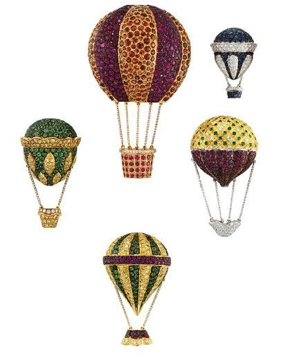 A CHARMING COLLECTION OF FIVE HOT AIR BALLOON BROOCHES