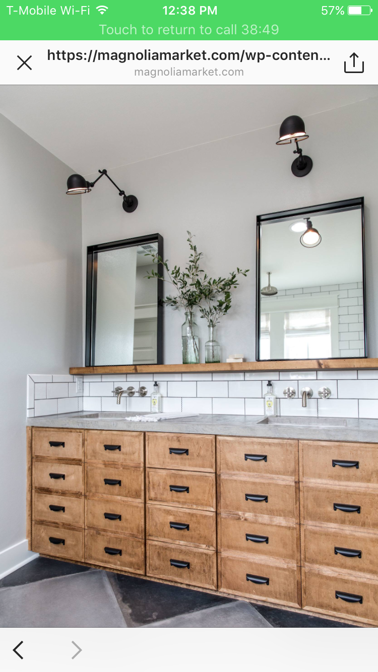 Love the rustic floating vanity with black accents and
