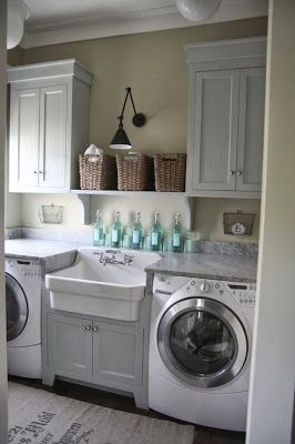 Nice looking laundry room—yet doesn't seem very practical or efficient with a sink in the middle❣