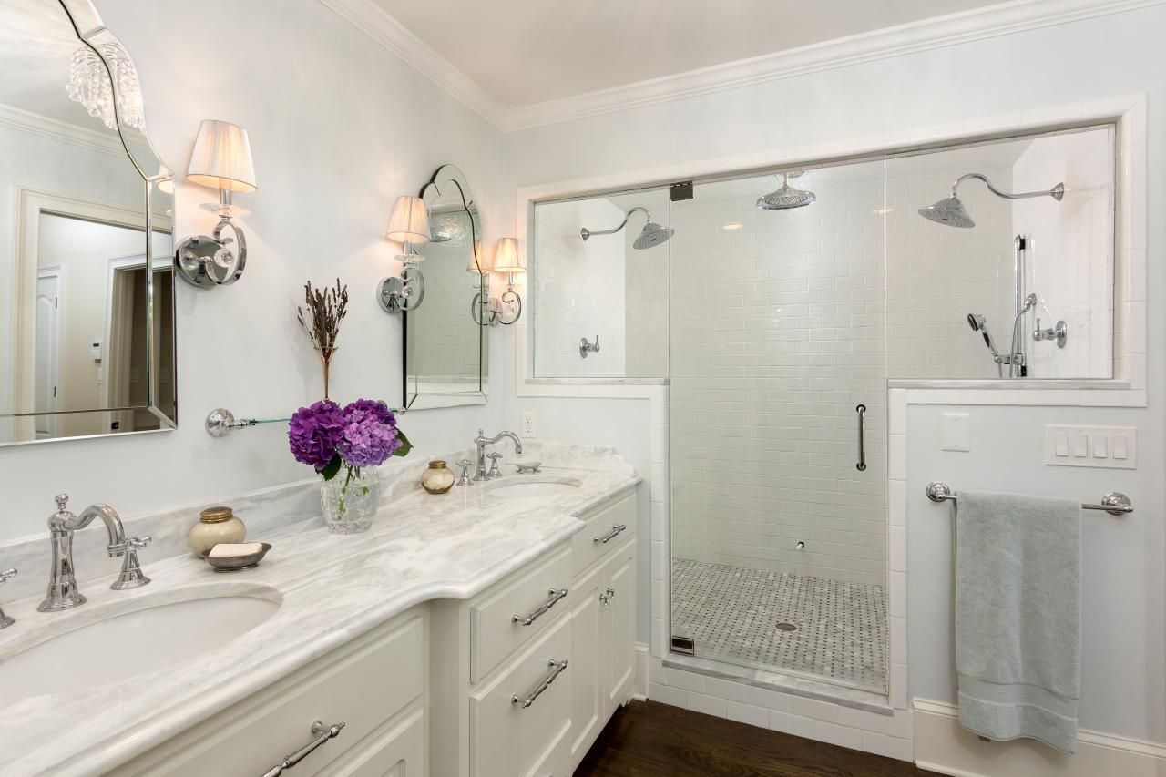 The large walk-in shower in this elegant traditional bathroom ...
