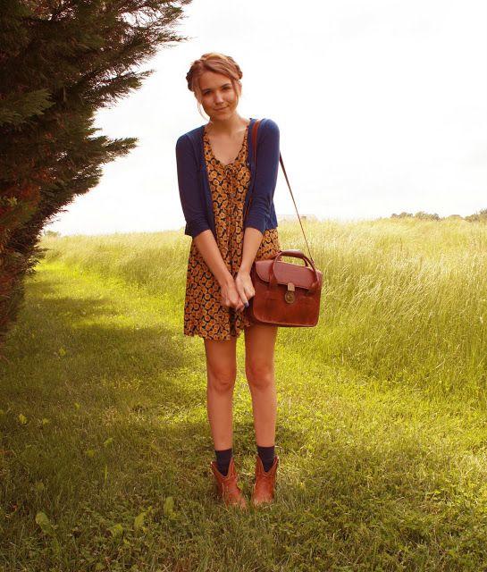 Sunflower dress + blue cardigan, leather bag.