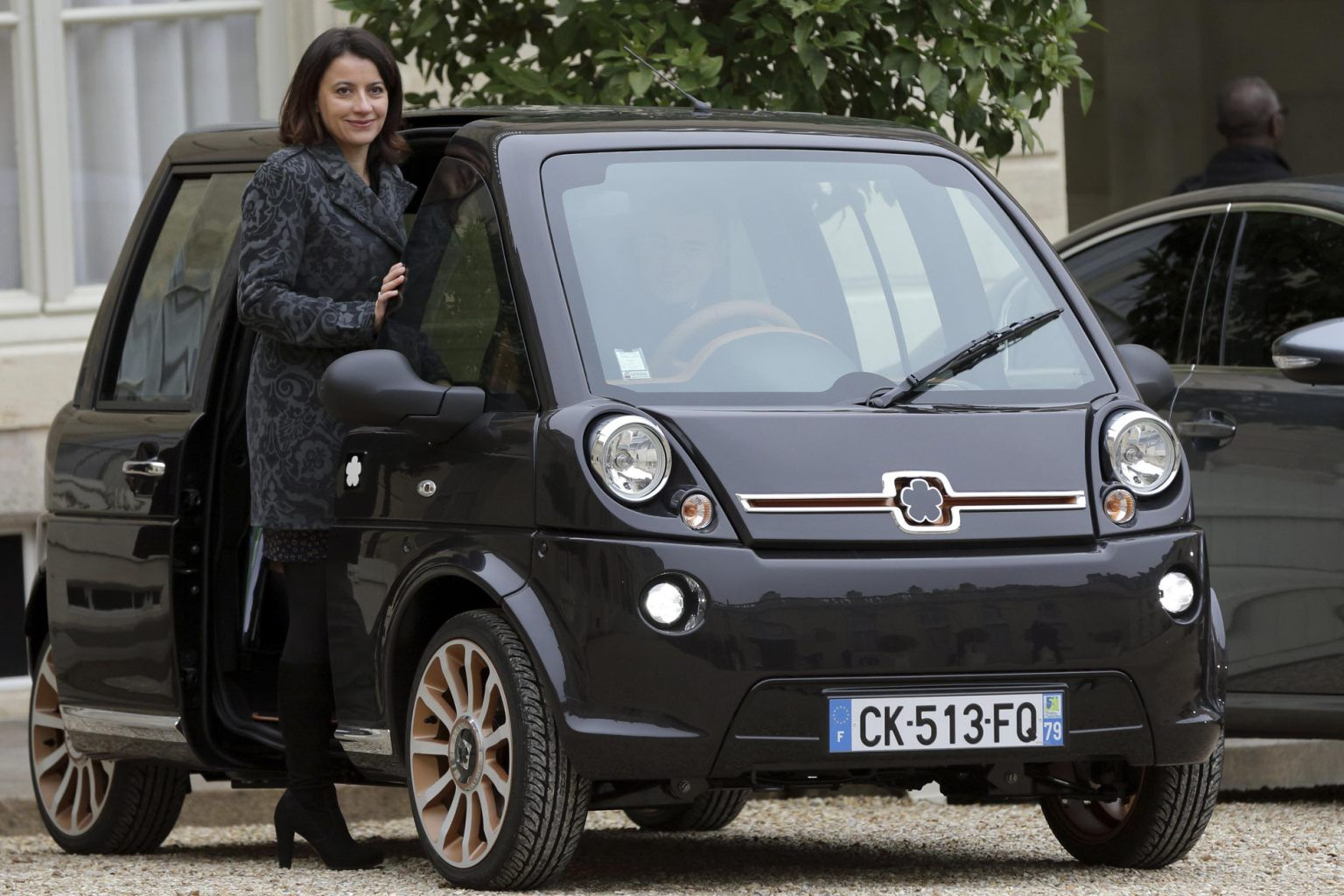 Image detail for -French Housing and Equality of Territories minister Cecile Duflot enters a Mia Electric car as she leaves the weekly cabinet meeting at the Elysee Palace...