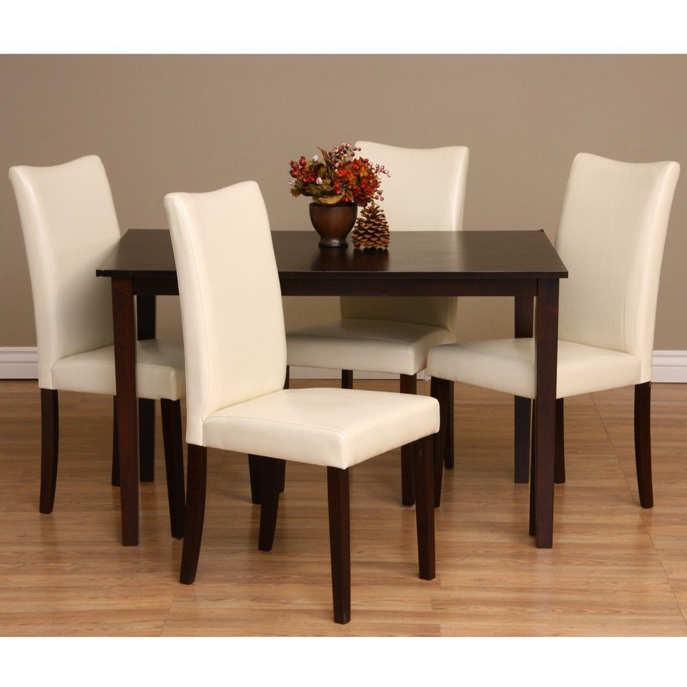 Upgrade your dining experience with this contemporary oak wood 5 piece dining set. The cappuccino finished table looks sleek and luxurious against the chalk colored chairs and will add an unforgettable touch of class to your dining interior.
