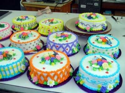 buttercream decorated cakes cakes decorated with various types of flowers made with - Decorated Cakes