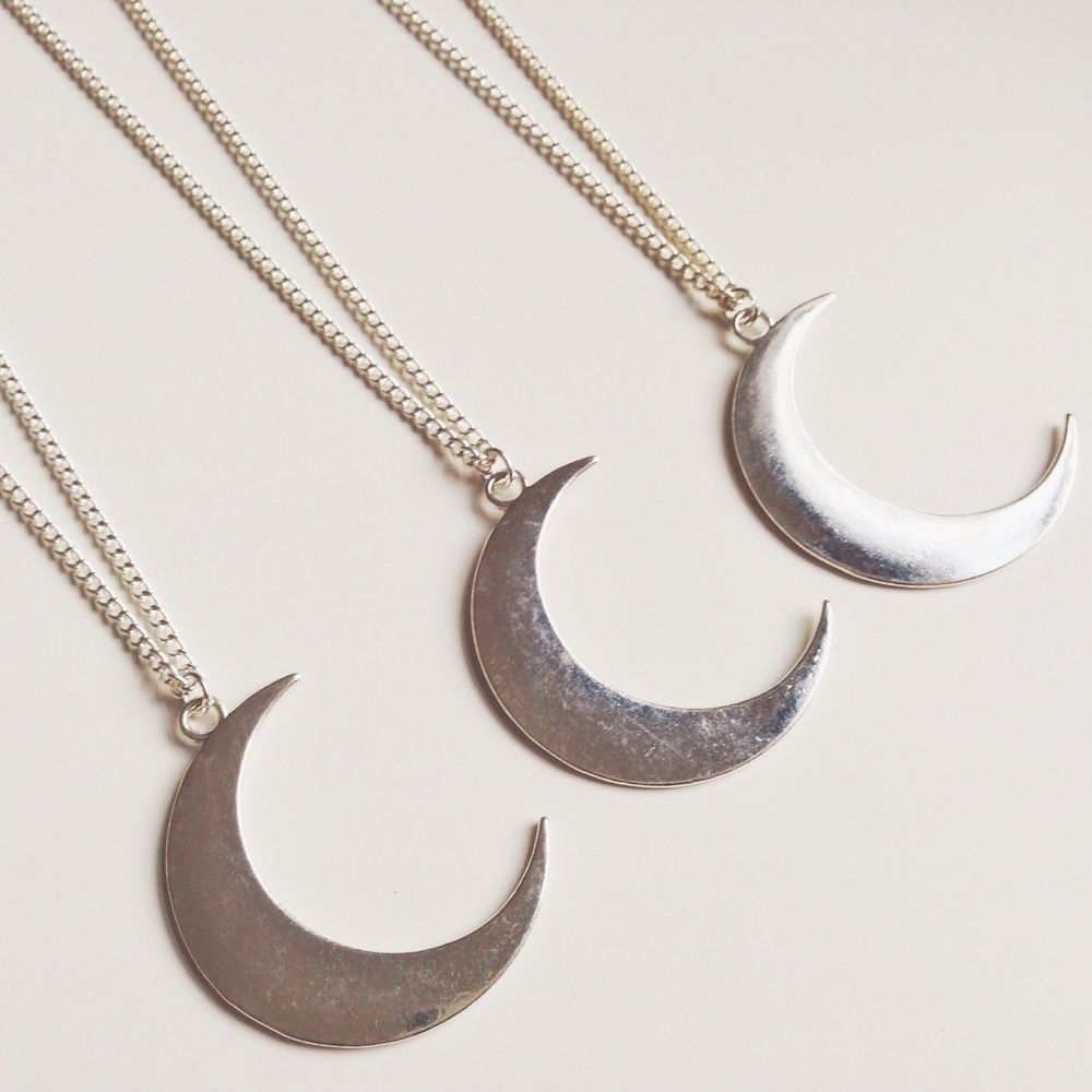 """A silver tone crescent moon pendant on an 18"""" silver plated chain. Metal alloy pendant (44x32mm) - cannot guarantee lead and nickel safe.Silver plated chain - lead and nickel safe."""