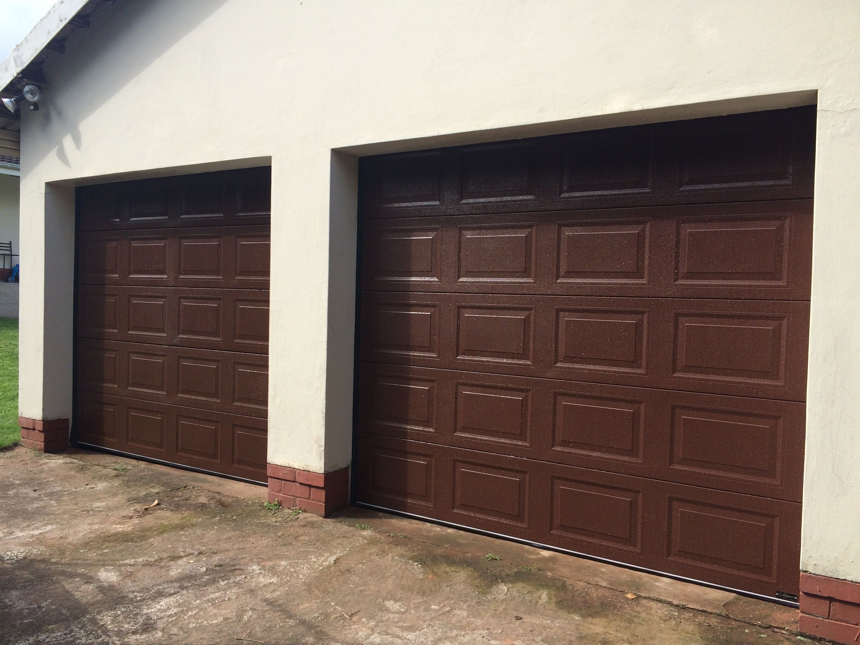 door garage fiberglass vgroove walnut doors