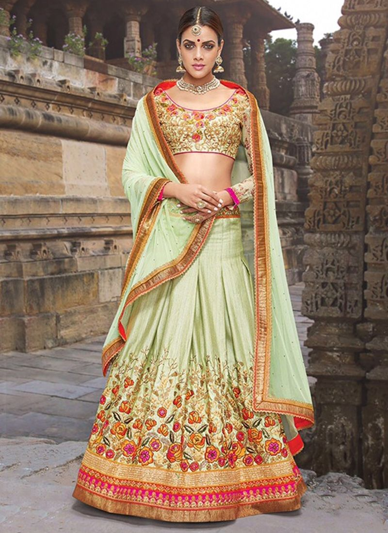 Sensible colors and excellent designs and romantic moods are reflected with an alluring style. Steal the hearts away with this sea green silk a line lehenga choli. The embroidered, patch border and re...