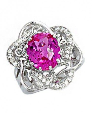 our 4.11 CTW Pink Sapphire Sterling Silver Ring will add the right amount of sparkle to your holiday outfit.