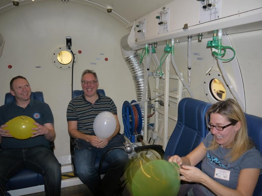 Delegates on our 2014 Dive Accident Responder Course (DARC) preparing to see the effects of pressure on a balloon during a 'pot' dive in a hyperbaric chamber.