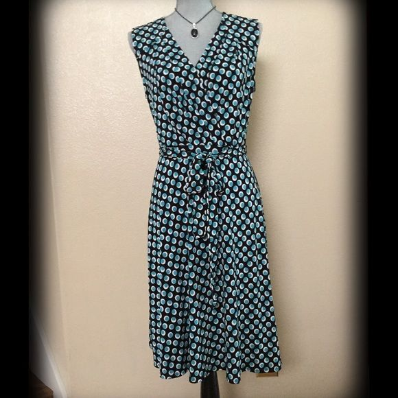 "Polka Dot Mid Length Dress NWOT⚫️Stretchy 93% Polyester and 7% Spandex Dress.  Black background with white and turquoise green polka dots. Beautiful front bodice criss crosses with a matching belt.  I am 5'7"" and the length is right below my knee.  Fits very nice.  Easy wash and wear fabric. Size Medium Dresses Midi"