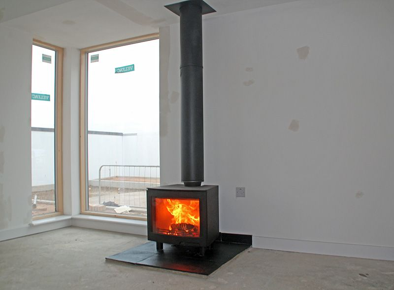Contura i5 wood stove with new stainless steel chimney system and slate tiled hearth. Fitted in a new build house for Countryside Properties 2013