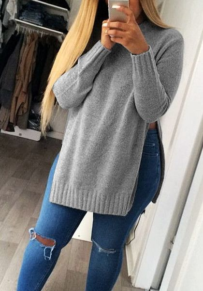 This grey side slit tunic sweater features a crew neckline and ...