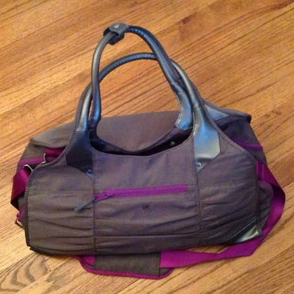 Athleta gym bag Hardly used athleta gym bag. 2 separate zippered compartments of equal size to separate dirty and clean clothes. Separate sleeve for shoes. 3 smaller zipper compartments for gadgets. Athleta Bags