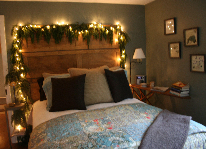 Master bedroom headboard  Cedar garland in the master bedroom over an english pine headboard