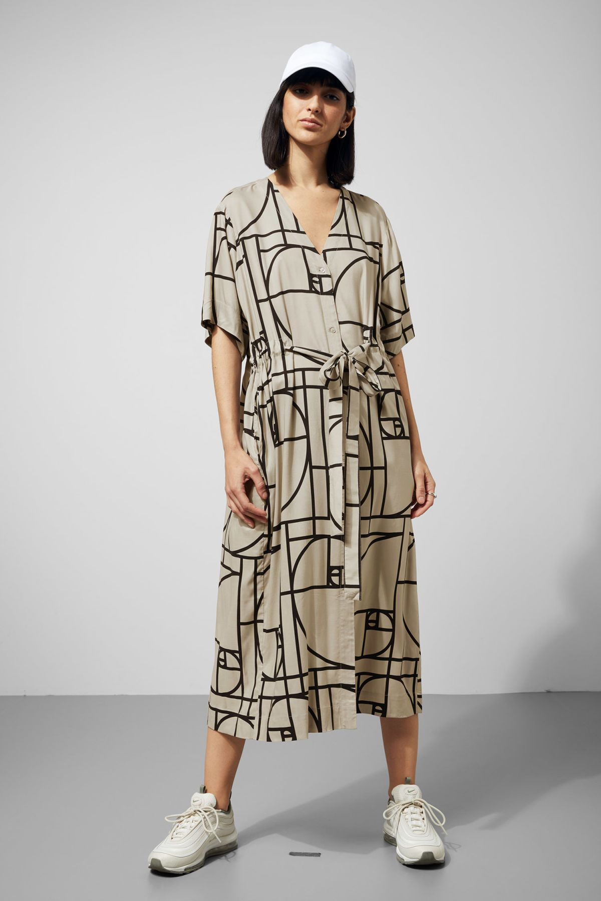 9953ec4b480e The Chalk Shirt Dress brings the warm season feeling closer with its light  material and easy cut. This maxi dress has a deep V-neck