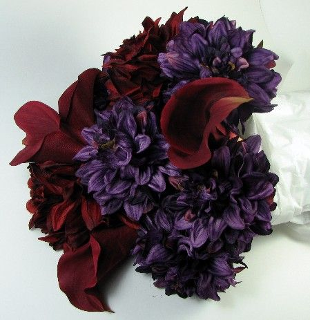 dahlias and calla lillies..my bouquet will be similar to this with some orange in it too :)