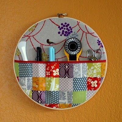 Wall pocket using an embroidery hoop. Function and beauty for a sewing space --  to hang on sewing machine side of expidite. Could work for small, always needed tools.