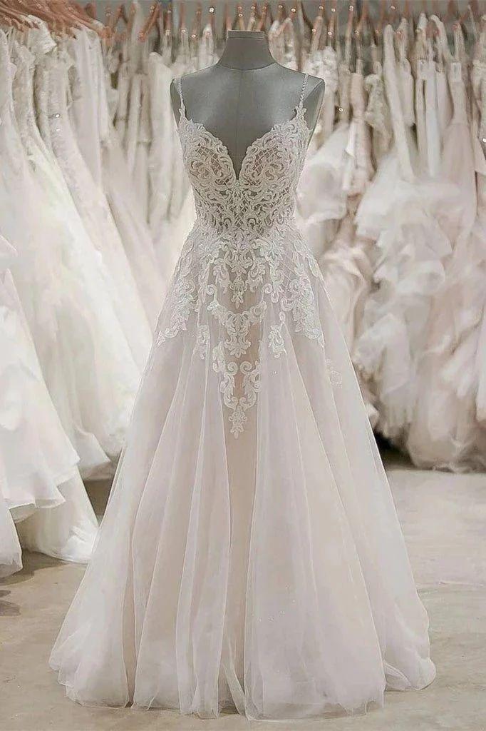 Photo of OkdressesA Line Spaghetti Straps Tulle Wedding Dresses