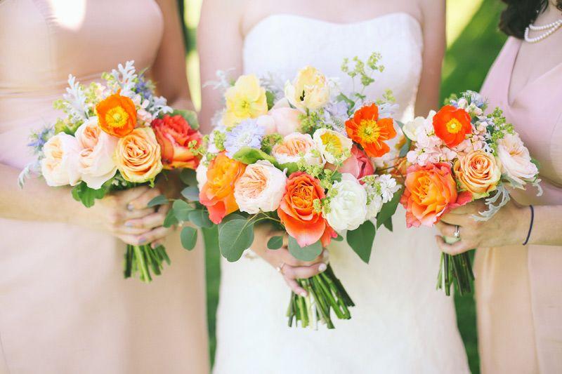 Bride and bridesmaids wedding flower bouquets in orange peach bride and bridesmaids wedding flower bouquets in orange peach yellow and blue mightylinksfo