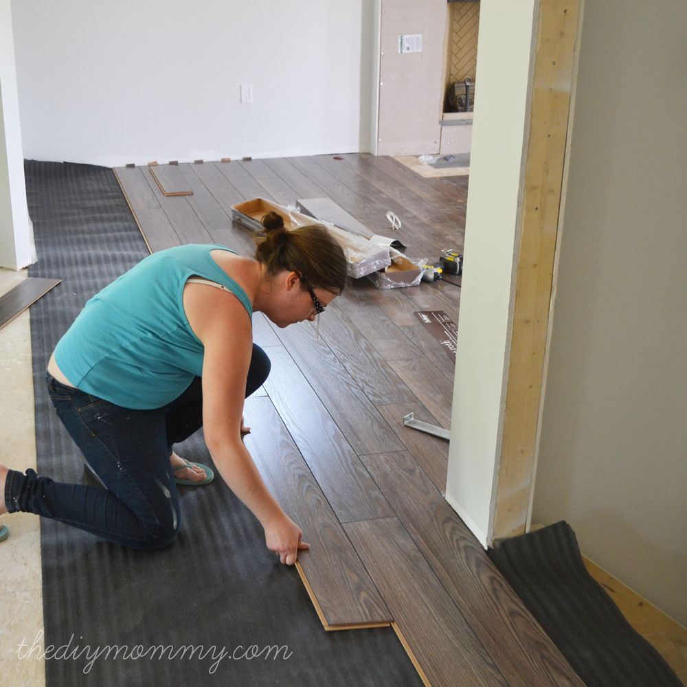 Installing Our Laminate Flooring Our Diy House Diy Wood Floors