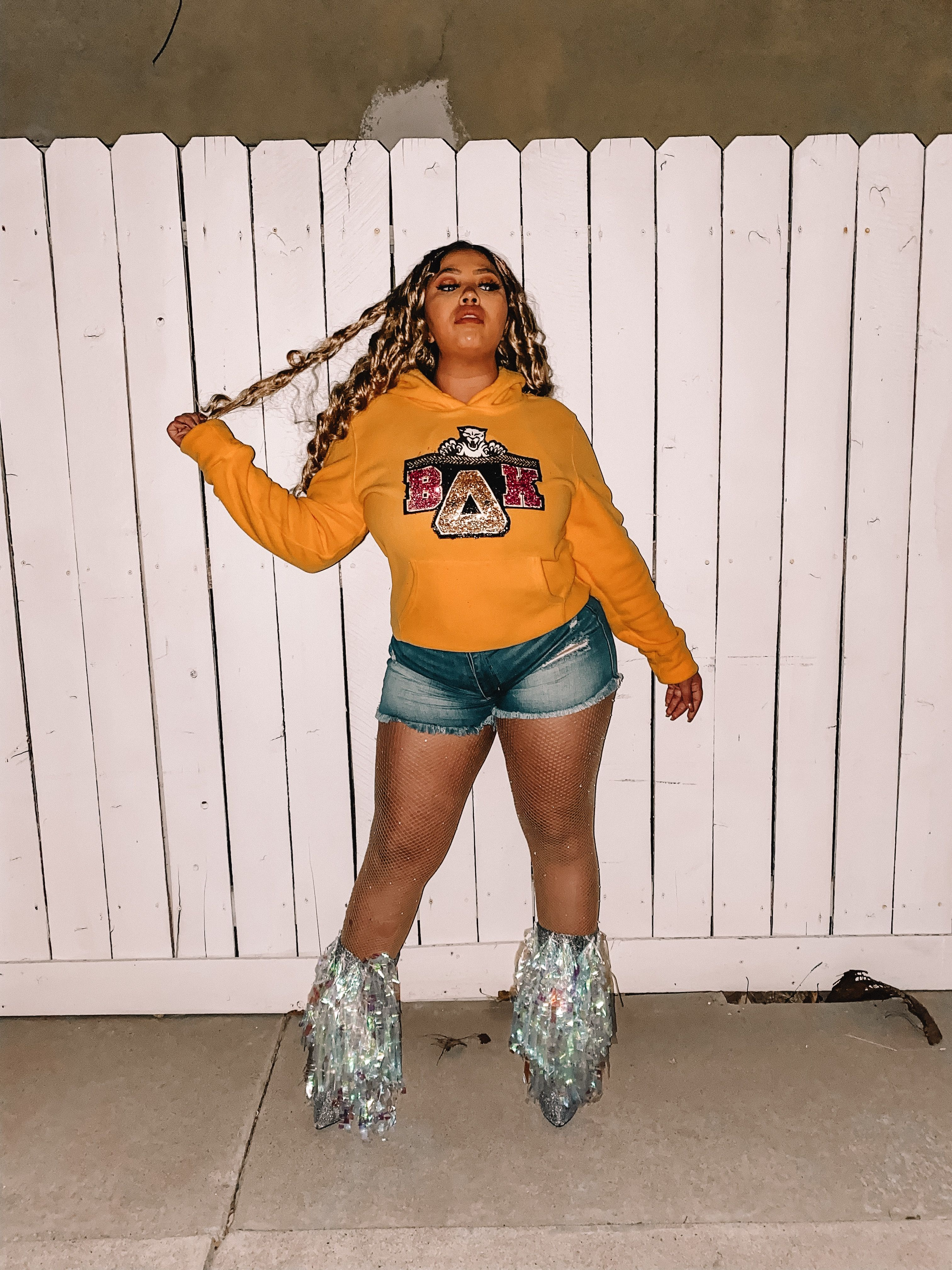 This is Beyoncé's Coachella outfit. Wig Wish Sweater