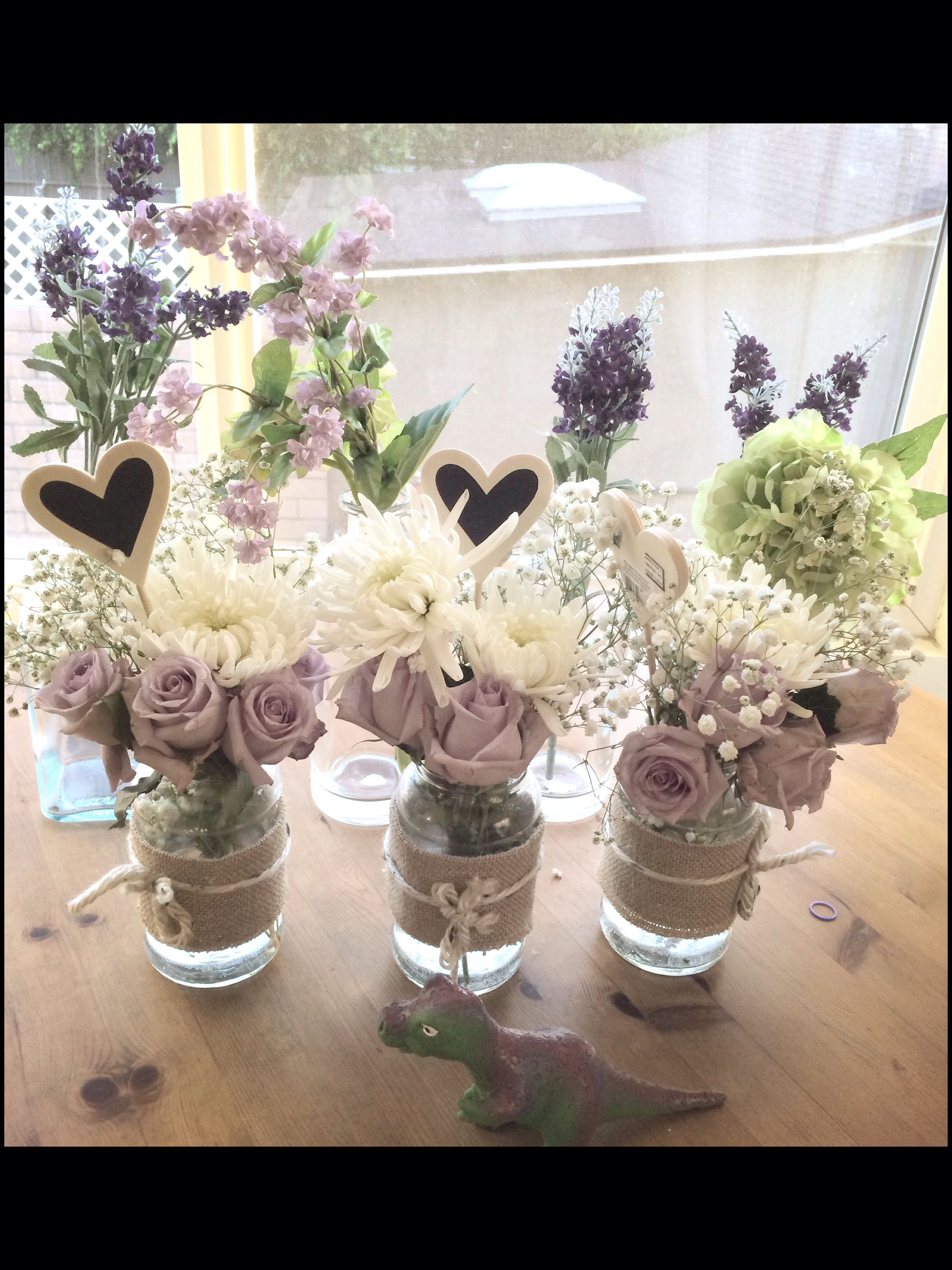 Simple centerpieces I made for my mom's birthday using ragu sauce jars! #diy #lavender #burlap #babysbreath #flowers 5/3/14