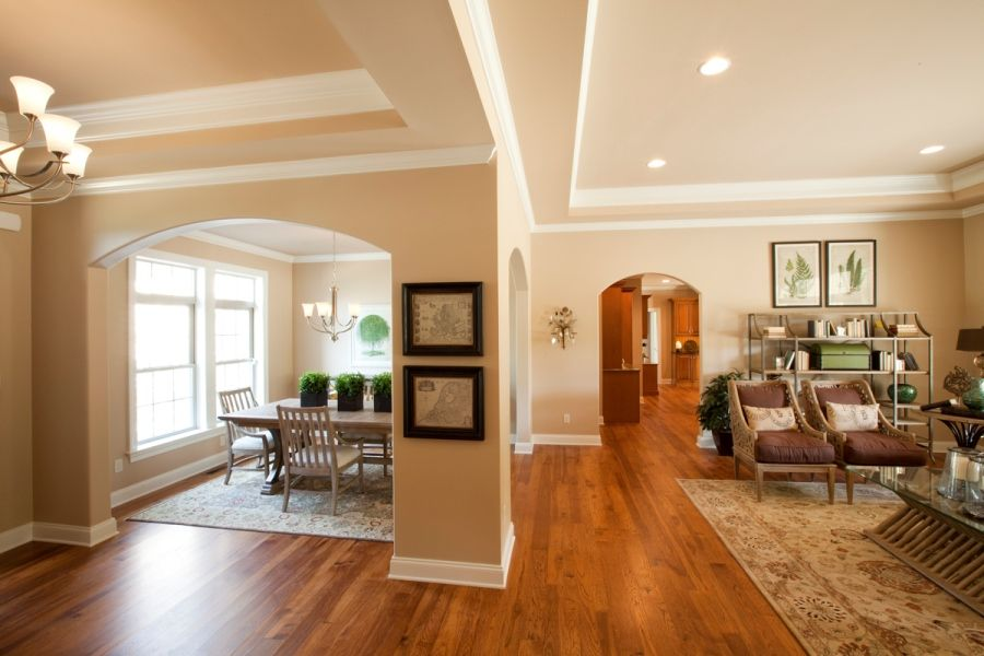 Open Foyer Living Room And Dining Separated By Columns Arched Openings