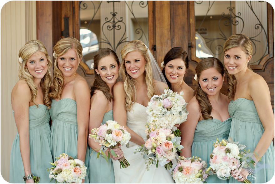 pretty color scheme. I like the bouquets and the bride's hair down style. Don't like the bridesmaid side ponies