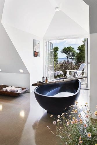 Love the way the shapes in this #luxury bathroom flow. Beautiful view too.