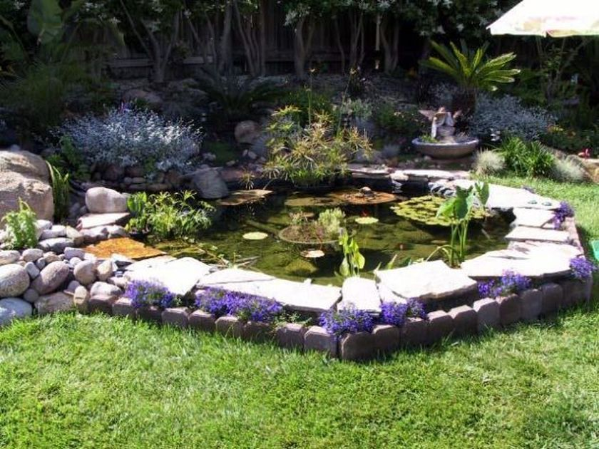 Small Backyard Pond Designs a simple bright blue garden pond with a tall center fountain small enough to fit Beautiful Backyard Fish Pond Landscaping Ideas 15