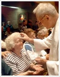 CME's: This is a picture of a women getting blessed with the sign of the cross on her forehead from the priest. When we are sick and need Gods help, we ask for a priest to bless us and help us change to be healthy and in a good spirit. This relates to the sacrament of anointing the sick because when we are sick, we try to change into something better.