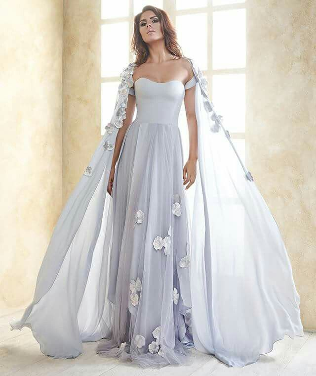 """Kristina Fidelskaya of Dubai has released a capsule collection entitled """"Noor"""" for the upcoming Eid celebrations. The 16-piece offering features gowns and mid-length dresses in colours of soft cream, ivory, champagne, shimmery baby blue and gradients of grey, with the use of delicate silks, charmeuse and georgette fabrics, alongside embellished details of floral appliques and lace accents. More: http://senat.us/1sGlnJ0"""