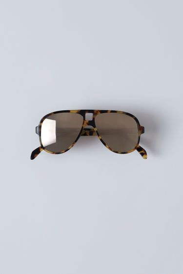 Acne Studios Hole Tortoise Gold Mirror 375x   Accessories   Acne ... 3619a4ab474