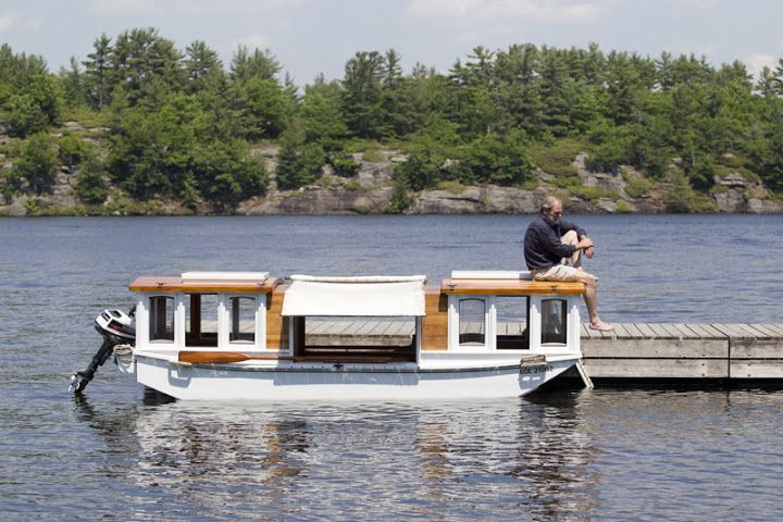 Wilkinson Photo: Little House On The Water Paul Rainey and his tiny houseboat that he designed and built himself. He's taken it through Florida and the Erie Canal. It can be powered by the motor or rowed from the centre of the boat.