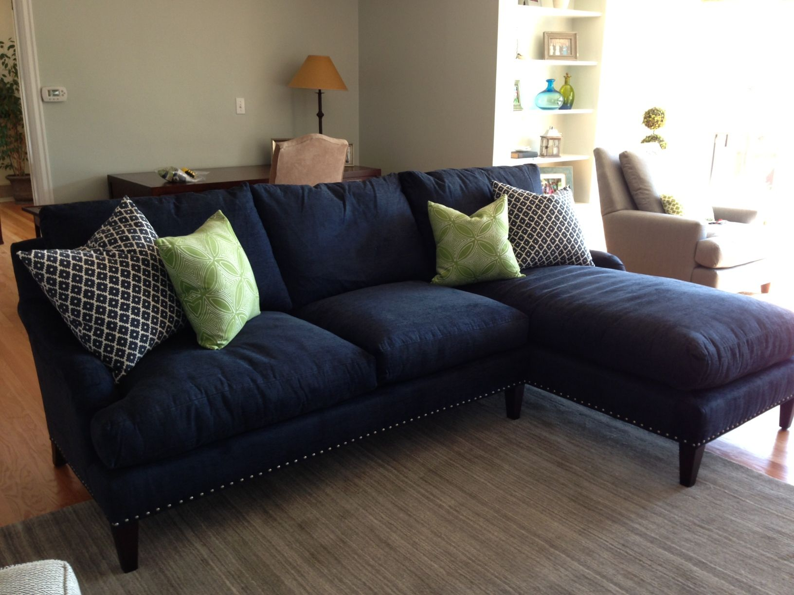 5163 Sectional in Navy w nailhead and green apple toss pillows from