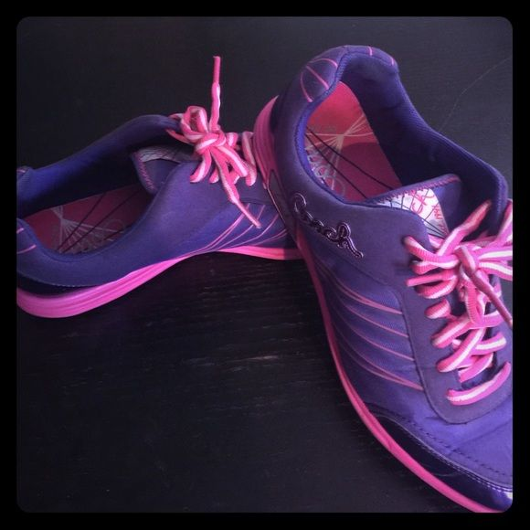 Coach gym shoes Purple and pink coach gym shoes. Still in good condition worn only a few times Coach Shoes Sneakers