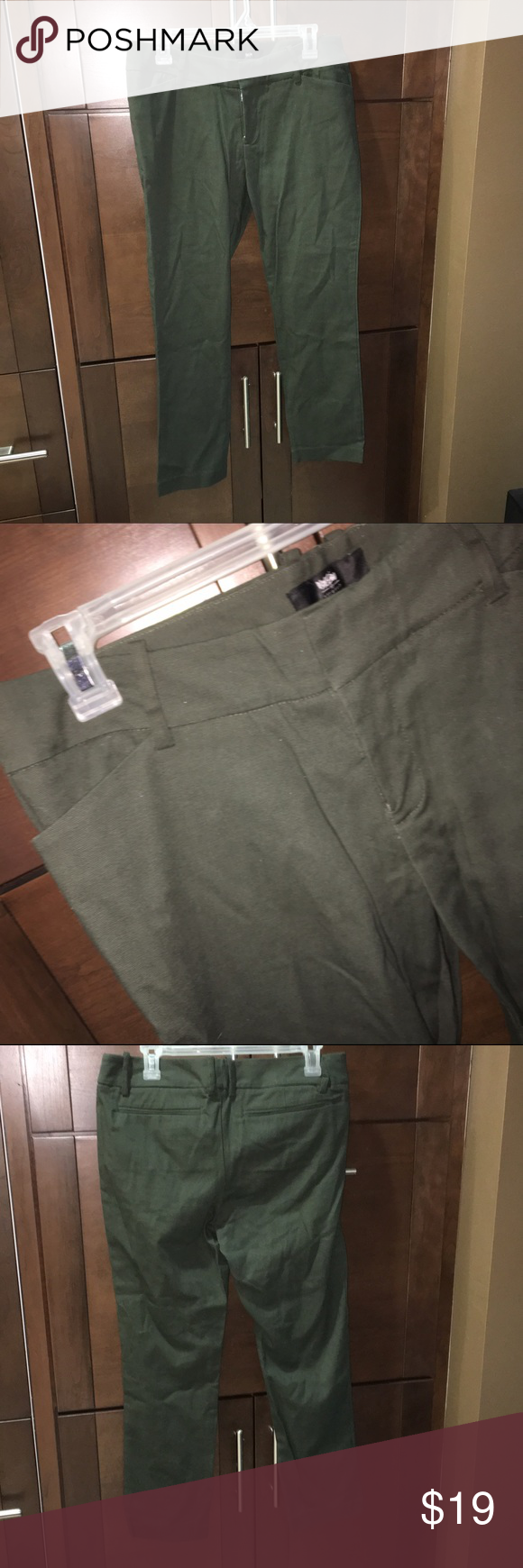 "Skinny ankle pants I don't think I've ever worn these but no tags. Pretty army green color. 97% cotton, 3% spandex. Zipper fly front with waistband hooks, flat front. 27"" inseam. 13"" leg opening at bottom. Mossimo Pants Ankle & Cropped"