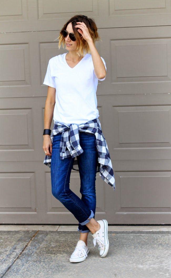 White v-neck, dark denim & a plaid shirt tied around the waist ...